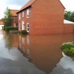 21.50 side of 34 - Trail off to right behind the house - showing now these houses flooded also from the front