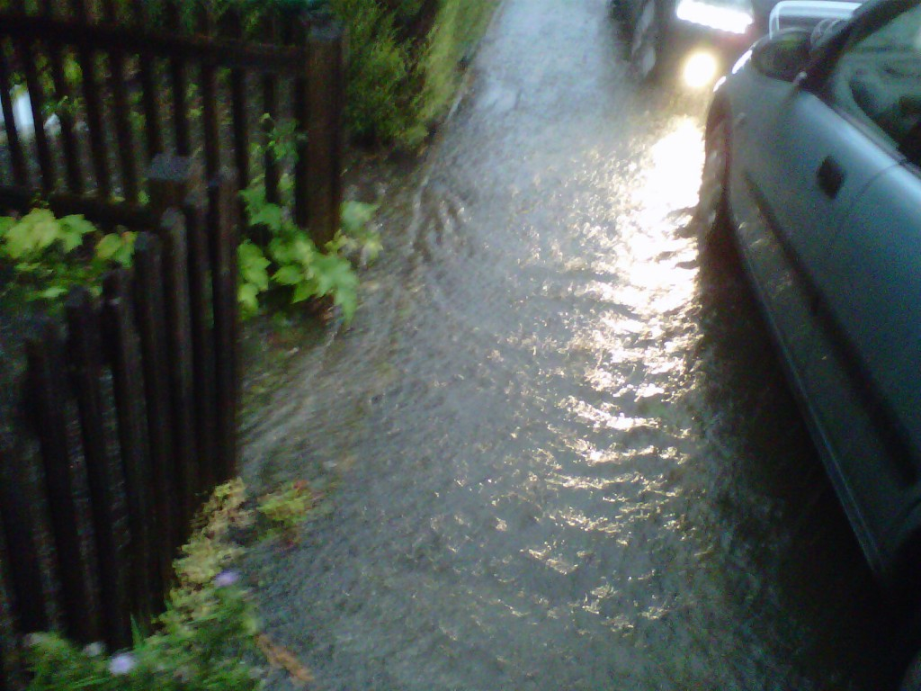 water (clear not muddy) over the pavement depth of kerb 7 cm