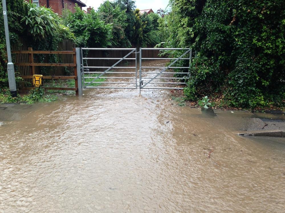 19.40 water exiting pathway to Kirklington Road
