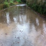 20/12/2012 Excess water pooling on Hopkiln Lane from Halam Road. If left unchecked this starts flooding into gardens and in bad conditions threatens houses. by Ben Huson