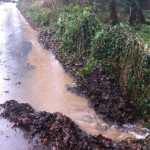 20/12/2012 Quick makeshift channel on Hopkiln Lane to funnel overflowing Halam Road water into the dyke to prevent flooding further down Hopkiln Lane by Ben Huson