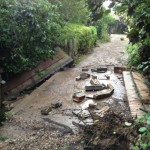The collapsed brickwork is what was formerly walls along the edge of the bridge on our driveway over the dyke. These collapsed due to the force of the water coming down the dyke.