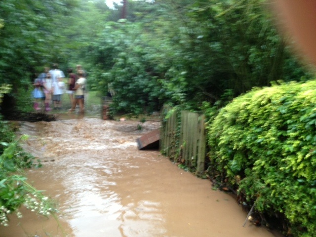 The (blurry) crowd scene shows folks from Westhorpe unable to get to our house over the dyke. This was effectively a watery crossroads where the water was flooding down our drive from the direction of Westhorpe Hall and then met the dyke flowing in the other direction.