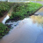 Trench cut through verge at bottom of Park Lane to prevent water running onto Nottingham Road.